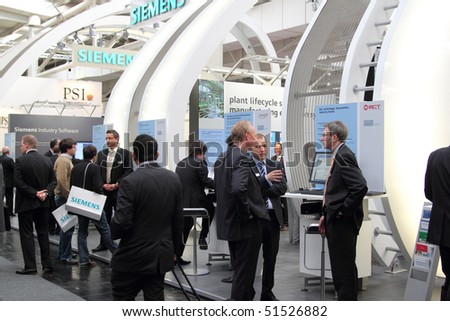 HANNOVER, GERMANY - APRIL 19:people on the stand of Siemens at the hannover industrial fair , Hannover Messe, April 19, 2010 in Hannover, germany - stock photo