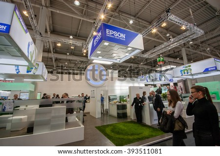 HANNOVER, GERMANY - MARCH 14, 2016: Booth of Epson company at CeBIT information technology trade show in Hannover, Germany on March 14, 2016. - stock photo