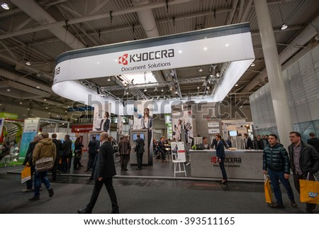 HANNOVER, GERMANY - MARCH 14, 2016: Booth of Kyocera company at CeBIT information technology trade show in Hannover, Germany on March 14, 2016. - stock photo