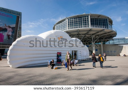 HANNOVER, GERMANY - MARCH 14, 2016: Cloud booth of Amazon Web Services company at CeBIT information technology trade show in Hannover, Germany on March 14, 2016. - stock photo
