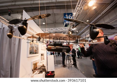 HANNOVER, GERMANY - MARCH 14, 2016: Drone equipped with Routescene UAV LidarPod survey module displayed at CeBIT information technology trade show in Hannover, Germany on March 14, 2016. - stock photo