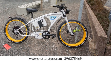 HANNOVER, GERMANY - MARCH 15, 2016: Electric bike Byke near SAP company booth at CeBIT information technology trade show in Hannover, Germany on March 15, 2016. - stock photo