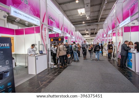 HANNOVER, GERMANY - MARCH 15, 2016: Multiple small China booths at CeBIT information technology trade show in Hannover, Germany on March 15, 2016. - stock photo