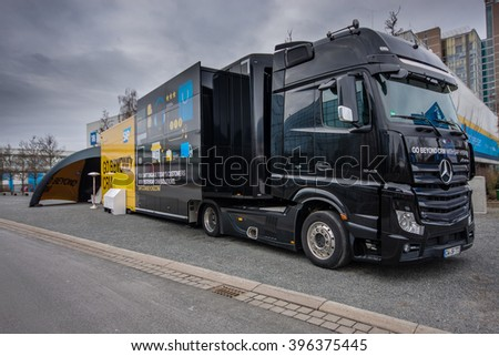 HANNOVER, GERMANY - MARCH 15, 2016: SAP Go Beyond CRM demo truck stands near SAP company booth at CeBIT information technology trade show in Hannover, Germany on March 15, 2016. - stock photo