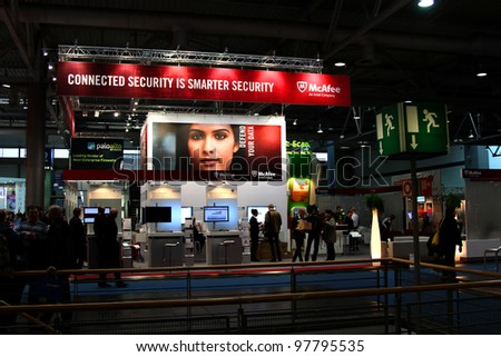 HANNOVER, GERMANY - MARCH 10: stand of McAfee on March 10, 2012 in CEBIT computer expo, Hannover, Germany. CeBIT is the world's largest computer expo