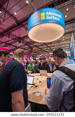 HANNOVER, GERMANY - MARCH 14, 2016: Surface stand in booth of Microsoft company at CeBIT information technology trade show in Hannover, Germany on March 14, 2016. - stock photo