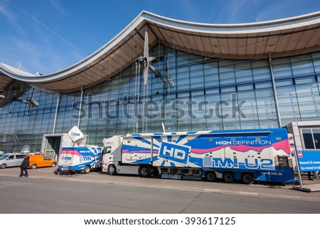HANNOVER, GERMANY - MARCH 14, 2016: TVN truck with video and tv studio at CeBIT information technology trade show in Hannover, Germany on March 14, 2016. - stock photo