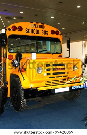 HANNOVER - MARCH 10: the School bus on March 10, 2012 at CEBIT computer expo, Hannover, Germany. CeBIT is the world's largest computer expo - stock photo