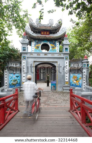 HANOI - APRIL 18: Visitor to the Ngoc Son temple in Hanoi on April 18, 2009. Accessed via the Huc Bridge, it is dedicated to hero Tran Hung Dao who defeated invading Mongolian armies thrice. - stock photo