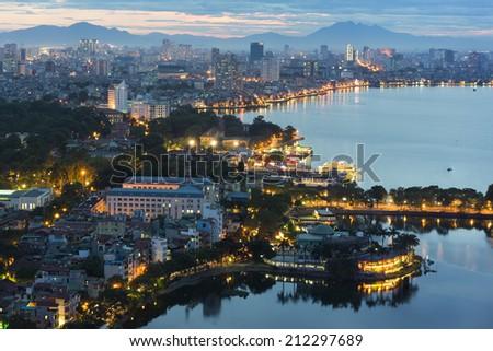 Hanoi cityscape at twilight at West Lake - stock photo