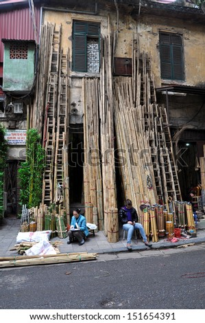 HANOI - FEB 19: Unidentified street sellers selling bamboo. In the communist Hanoi as a result of Doi Moi, privately owned enterprises were permitted in business. On Feb 19, 2013 in Hanoi, Vietnam