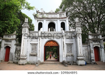 HANOI - JULY 20: Main entrance gate to the temple of Literature on July 20, 2012 in Hanoi, Vietnam. The temple of Literature, built in 1070, is the first Vietnamese university. - stock photo