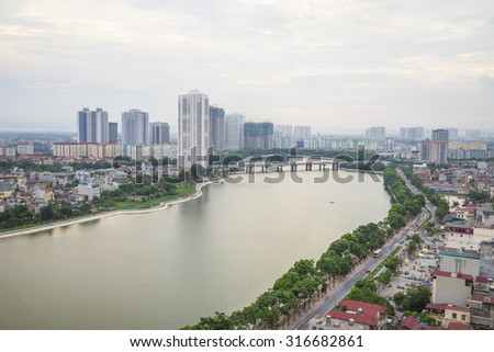 Hanoi skyline cityscape at sunset period. Linh Dam lake