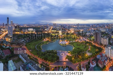 Hanoi skyline cityscape at twilight period. Aerial view of Cau Giay park, west of Hanoi