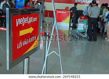 Hanoi, Vietnam - Apr 4, 2015: Guiding sign to check-in queue of a local airline company at Noi Bai International Airport.  - stock photo