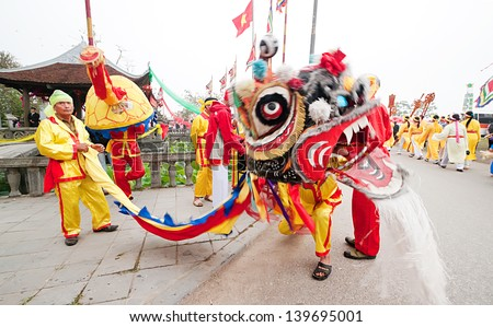 HANOI, VIETNAM-APRIL 14: A group of unidentified people perform dragon dance during Tet Lunar New Year celebrations on April 14, 2013 in Hanoi, Vietnam. This is a traditional cultural activity.