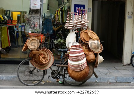 Hanoi, Vietnam - April 21, 2016: An unidentified  Street vendors. They sell everything from flower, fruits, handicraft goods, bamboo and rattan goods to food.