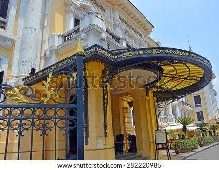 Hanoi, Vietnam - April 15, 2015: Detailed view of the Historic Hanoi Opera House building including side entrance and canopy in French Colonial style. - stock photo