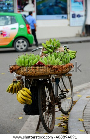 Hanoi, Vietnam, April 19, 2016:  Life in Vietnam - Unidentified fruit vendor in a street in Hanoi Vietnam. This is a specific tradition in Hanoi old quarter.