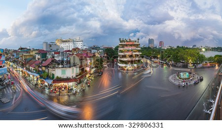 Hanoi, Vietnam - Aug 28, 2015: Aerial panorama view of Hanoi cityscape at twilight at intersection locating next to Hoan Kiem lake, center of Hanoi.