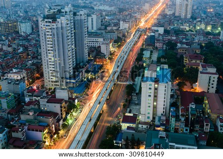 HANOI,VIETNAM-AUG 24, 2015 - Aerial view of Nguyen Trai street in Thanh Xuan district in twilight. This view is toward the Northeast of Hanoi. Cityscape and high speed, motion concept