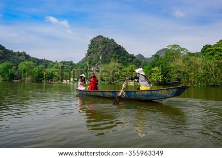 HANOI, VIETNAM - DEC 27, 2015: Tourist sit on boat to visit HUONG Pagoda. HUONG Pagoda Festival is the biggest and longest annual festival in Vietnam.