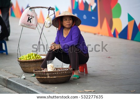 Hanoi VIetnam December 6 2016 Life in Vietnam- Hanoi,Vietnam Street vendors in Hanoi's Old Quarter.Street vendors sell a lot of things, fruits, flowers, personal items, etc..