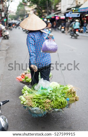Hanoi Vietnam December 1 2016 Life of small street corner in Hanoi.Street vendors sell a lot of things, fruits, flowers, personal items, etc..