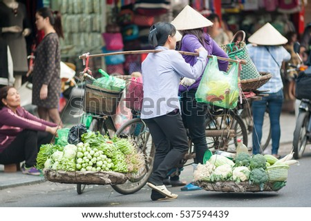 Hanoi Vietnam December 11 2016 Life of small street corner in Hanoi.Street vendors sell a lot of things, fruits, flowers, personal items, etc..