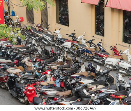 HANOI, VIETNAM-FEB 14,2016:Top view of a cramped parking lot with varieties of motorcycles in many brands and colors in downtown at sunset.Vietnam is the world second highest motorcycle-owning country