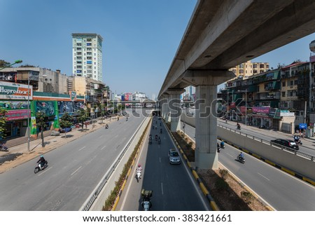 HANOI,VIETNAM-FEB 28,2016:Traffic at the intersection with many types of vehicle such as trucks, cars, buses, motorcycles, bikes and pedestrians on the street, thru tunnel and on overhead highway.