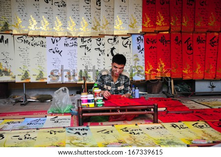 HANOI, VIETNAM, FEBRUARY 14: A master is writing ancient letter for everyone in lunar new year on February 14, 2013 in Hanoi, Vietnam. This is a tradition of vietnamese people in lunar new year