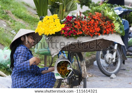 HANOI, VIETNAM - JULY 9: Unidentified flower vendor at the Quang Ba flower market on July 9, 2009 in Hanoi, Vietnam. Quang Ba market is considered the only flower wholesale market in Hanoi.