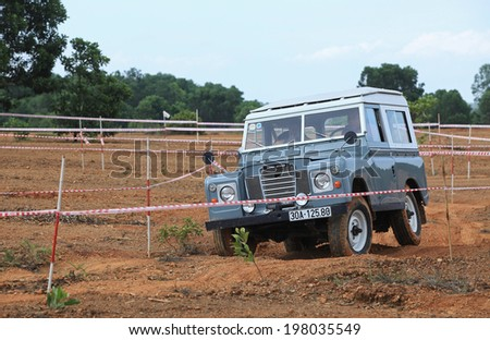 HANOI, VIETNAM - JUN 7, 2014: Unidentified Land Rover Defender running on off-road terrain of Vietnam Off-road Cup in a mountain area of Hanoi. This is an yearly event for off-road player in Vietnam.  - stock photo