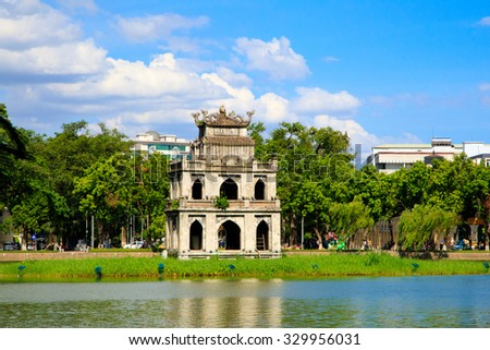 Hanoi, Vietnam - june 28, 2015: HoanKiem Lake, the little lake in the old part of Hanoi, Vietnam, with the Turtle Tower. Turtle Tower is the symbol of Hanoi,Vietnam. HoanKiem lake is center of Hanoi  - stock photo