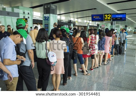 Hanoi, Vietnam - June 26, 2015: Lines of people waiting at boarding gate in Noi Bai International Airport - stock photo