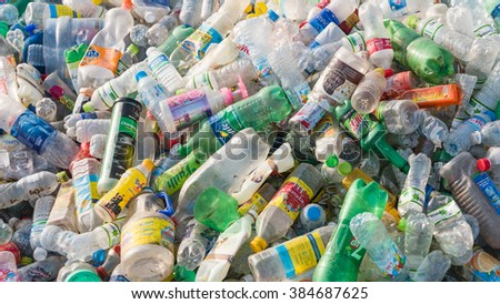 HANOI, VIETNAM-MAR 1, 2016: Close-up view plastic bottles of various drinks in the yard of a company specializing in ecological treatments. Large heap of plastic bottles and containers for recycling.