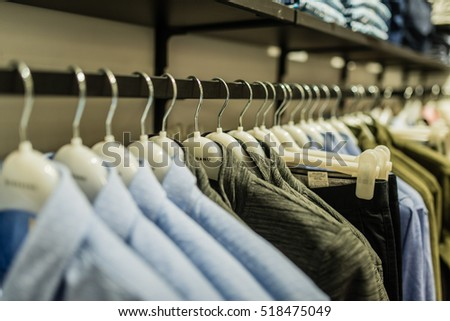 Hanoi, Vietnam 06 November 2016: clothes hang for sell in Vincom Royal city Shopping center. Model fashion neatly arranged