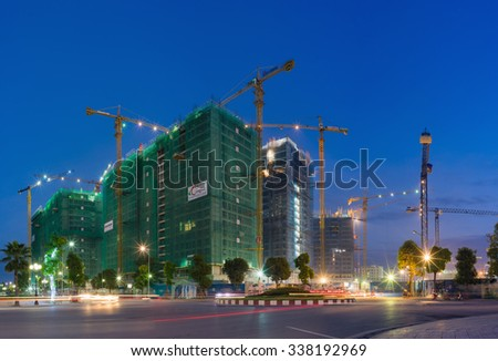 Hanoi, Vietnam - Oct 5, 2015: Apartment building construction site at night, Park Hill 3, in Times City complex. Times City is product of Vingroup, the biggest estate company in Vietnam - stock photo