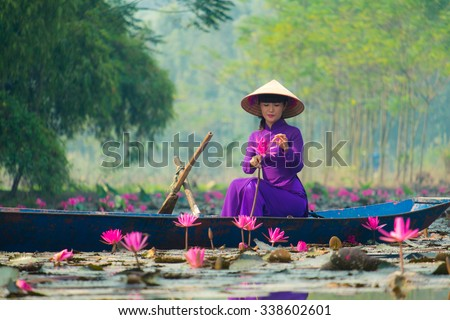 HANOI, VIETNAM - OCT 18: Girl on traditional boat in water lily river visit Huong pagoda in Hanoi, Vietnam on October 18, 2015. Huong pagoda in hanoi have beauty landscape for traveler.