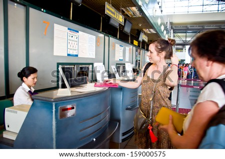 HANOI - VIETNAM - OCTOBER 13: Unidentified tourists check in for flight in airport, Hanoi.  On OCTOBER 13, 2013, in Hanoi, Vietnam - stock photo