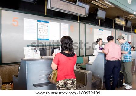HANOI - VIETNAM - OCTOBER 13: Unidentified tourists check in for flight in airport, Hanoi.  On OCTOBER 13, 2013, in Hanoi, Vietnam - stock photo