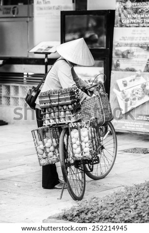 HANOI, VIETNAM - SEP 23, 2014: Unidentified Vietnamese manwith a bike charged with different products. 92% of Vietnamese people belong to the Viet ethnic group