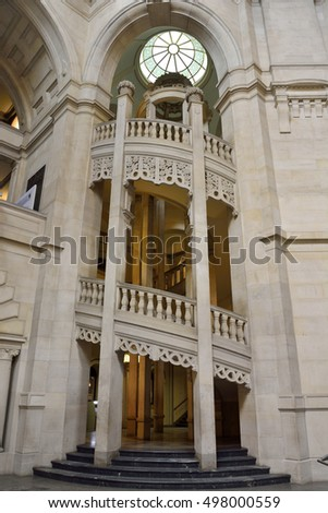 HANOVER, GERMANY - APRIL 18, 2016. Interior view of Neues Rathaus in Hanover, from ground floor flights of stairs, sculptures, columns, round ceiling window and other elements.