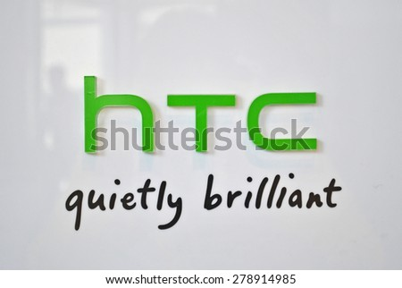 HANOVER, GERMANY, 20 March 2015 - Logo of HTC displayed during CeBit, the largest IT trade show in the world. - stock photo