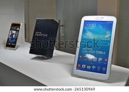 HANOVER, GERMANY, 20 MARCH 2015 - Samsung smart phones and tablets displayed in the booth of Google at CeBit, the biggest trade fair for information technology in the world. - stock photo
