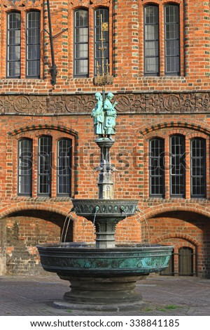 HANOVER, GERMANY - MAY 05: Market Church Fountain in Hanover on MAY 05, 2011. Fountain With Bronze Sculptures Near Marktkirche in Hannover, Germany. - stock photo