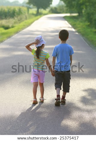 Hansel and Gretel, road to sun, children love, hold hands - stock photo