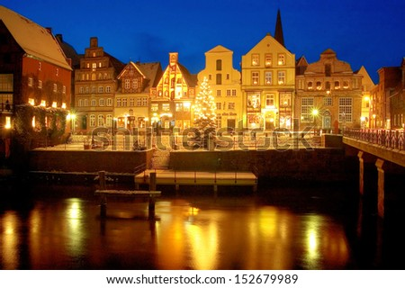 Hansestadt L�¼neburg, Germany: Famous Old Town and Old Harbour in Winter with  illuminated Christmass-Tree - stock photo