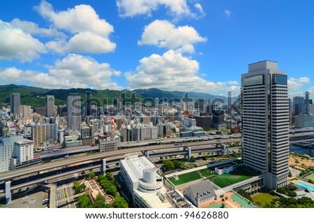 Hanshine Expressway winds through the cityscape of Kobe, Japan. - stock photo